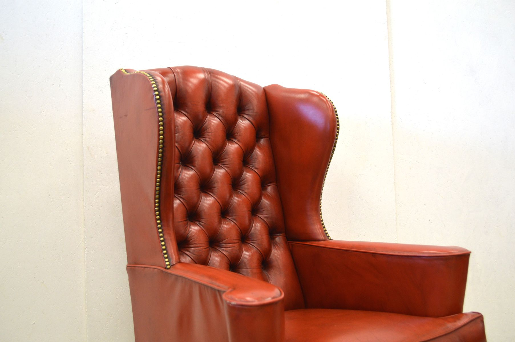 Tufted leather wingback