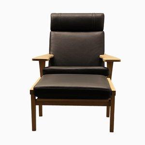 Dänisches Eiche & Schwarzes Leder Easy Chair und Ottoman von Getama, 1960er
