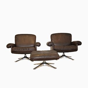 Vintage De Sede Swivel Armchairs and Ottoman 1970s, Set of 3