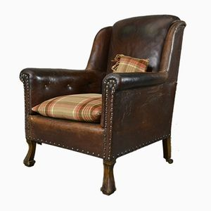Antique Brown Leather Armchair