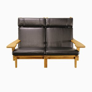 Danish Oak and Black Leather Two-Seater Sofa from Getama, 1960s