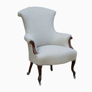 Antique French Walnut & Linen Armchair