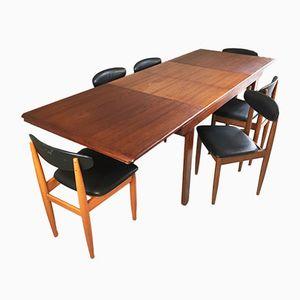 Extendable Teak Dining Table & Six Black Vinyl Chairs, 1970s