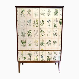 Tall Wooden Cabinet with Nordens Flora Illustrations by C.A. Lindman