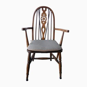 Vintage Chair with Armrests and Detailed Back