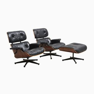 Vintage Lounge Chairs and Ottoman by Charles & Ray Eames for Vitra, Set of 3
