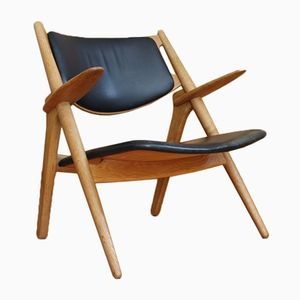 Danish CH28 Oak Sawbuck Lounge Chair by Hans Wegner for Carl Hansen & Son, 1952