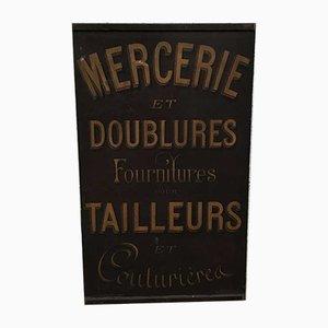 Publicité de Mercerie Tailor's en Feuille de Métal
