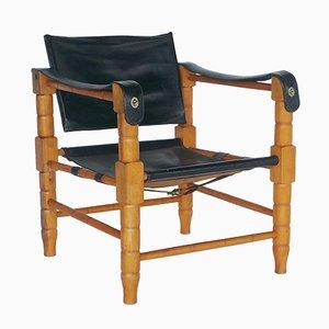Sessel aus Schwarzem Leder & Geschnitztem Holz, 1960er