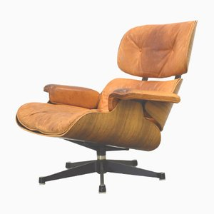 Poltrona in palissandro di Ray & Charles Eames per Herman Miller, anni '70