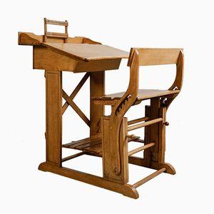 Scrivania antica da bambino con seduta incorporata