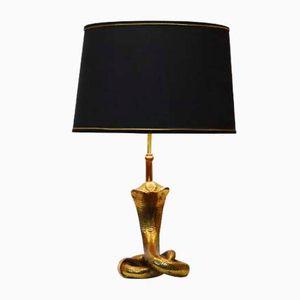 Lampada vintage con base a forma di cobra in ottone