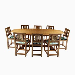 Vintage Solid Oak Dining Table and Eight Chairs by Robert Mouseman Thompson of Kilburn