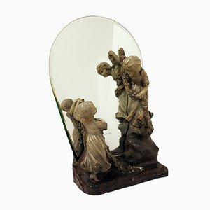 Antiker Spiegel mit Figuren von Goldscheider