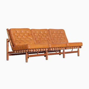Cognac 3-Sitzer Sofa von Ilmari Tapiovaara für Paolo Arnaboldi, 1958