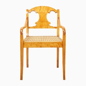Antique Armchair with a Woven Seat