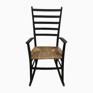 Schwarzer Skandinavischer Schaukelstuhl mit Sitzfläche aus Strohgeflecht