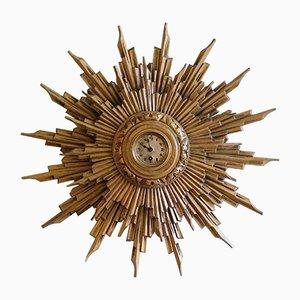 Orologio da parete antico a forma di sole in legno dorato, inizio XX secolo