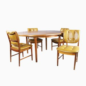 1970's mid centuryG Plan dining table and 4 tan vinyl dining chairs
