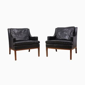 Danish Armchairs in Leather and Teak, 1960s, Set of 2
