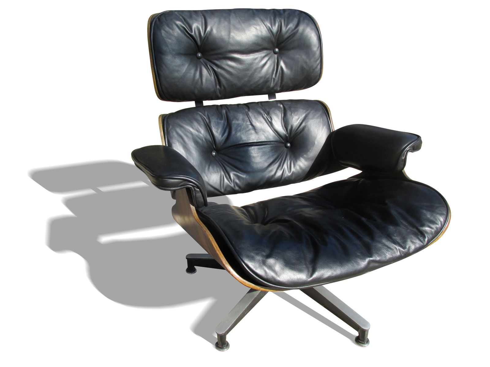 670 671 lounge chair and ottoman by charles and ray eames. Black Bedroom Furniture Sets. Home Design Ideas