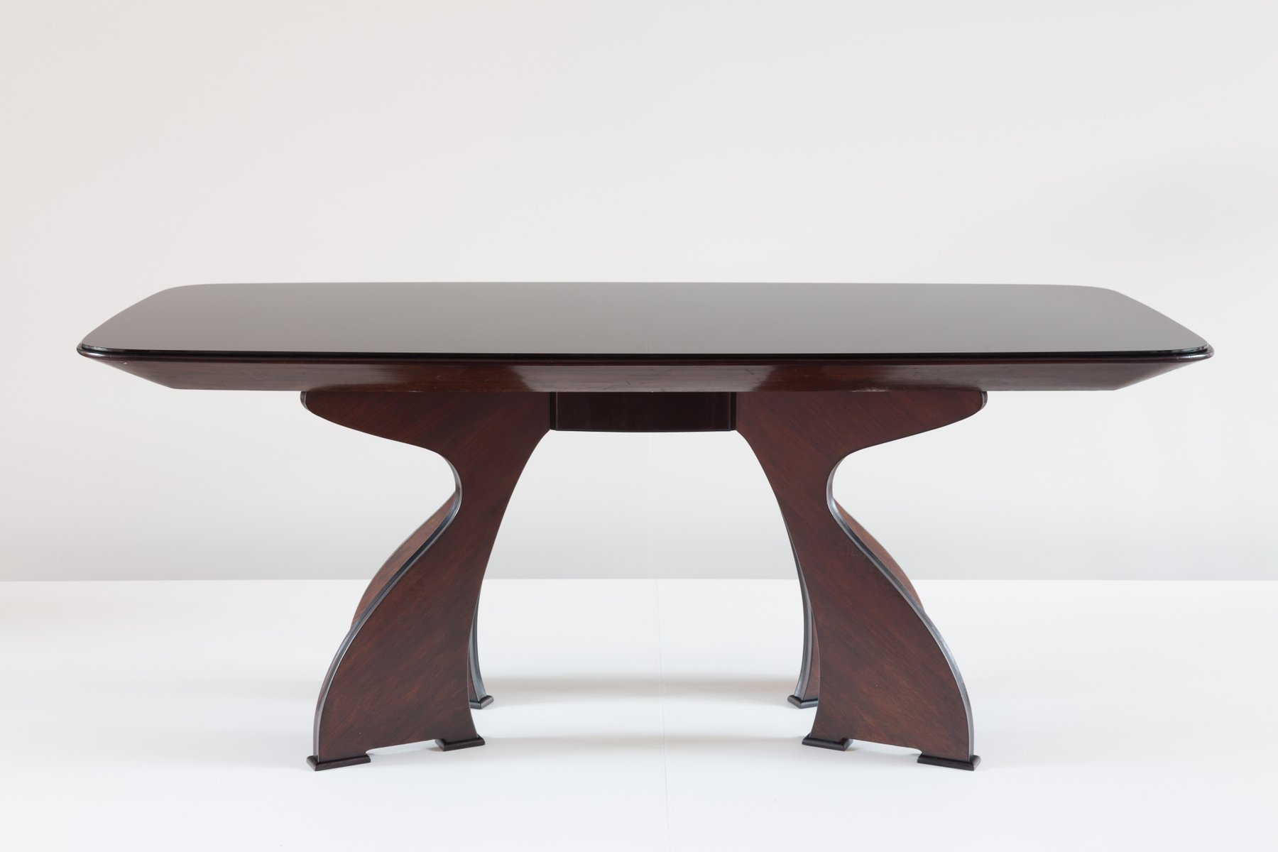 Sculptural Italian Modern Rosewood Dining Table for sale at Pamono