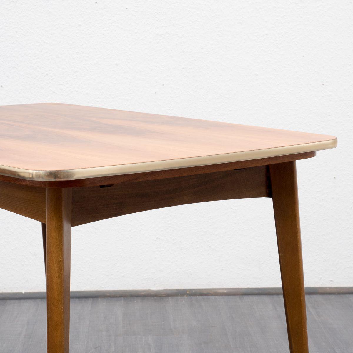 h henverstellbarer ausziehbarer esstisch aus nussbaumholz. Black Bedroom Furniture Sets. Home Design Ideas