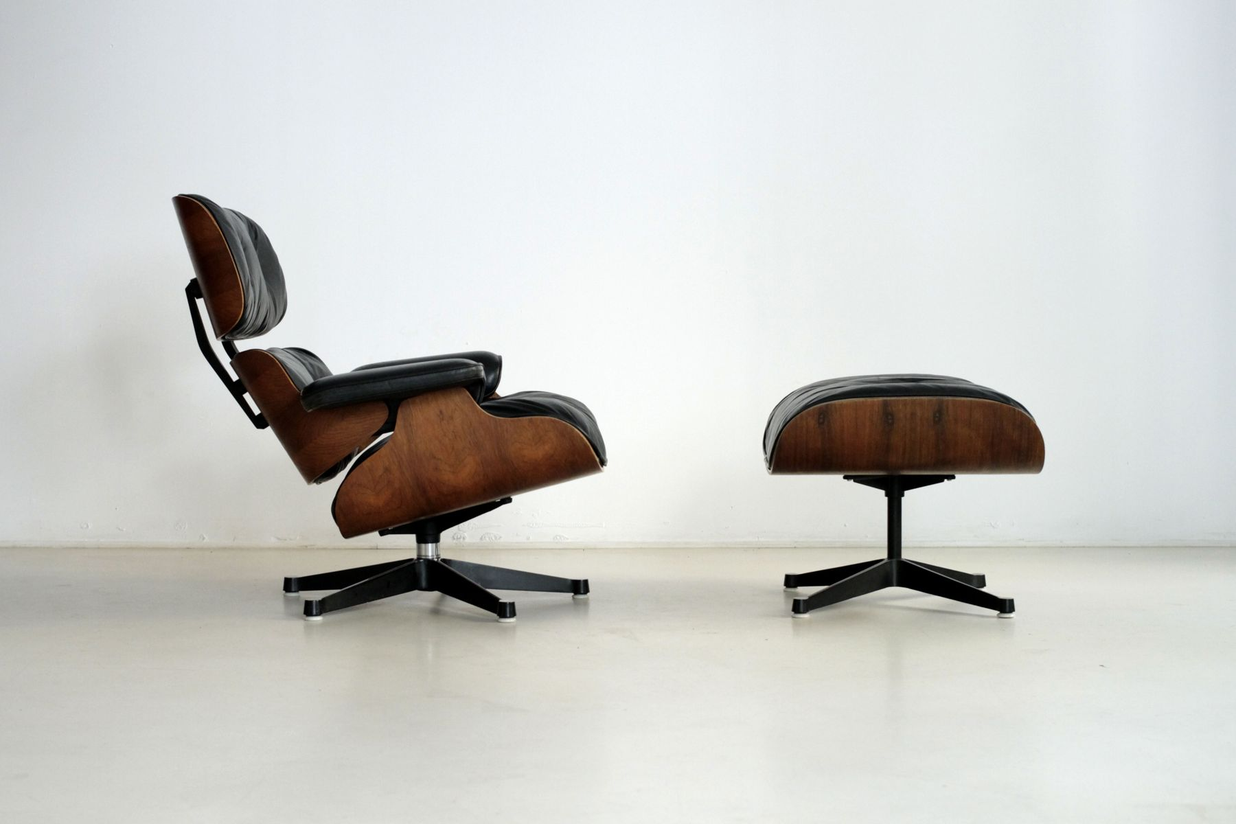 vintage swivel chair and ottoman by charles ray eames for herman