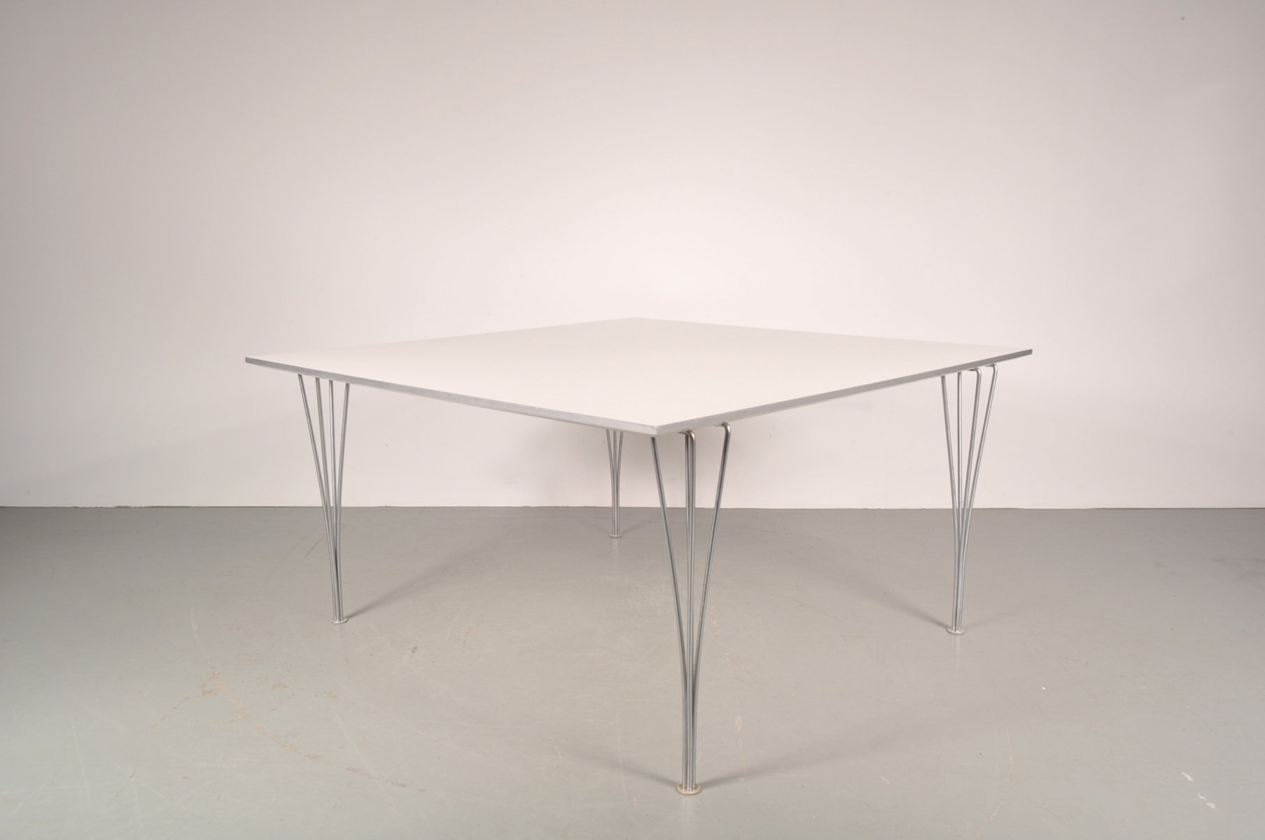 Large white square dining table on chrome metal legs from for Large white dining table