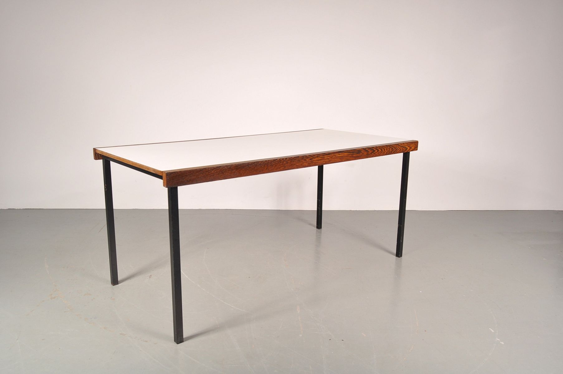 Weng white dining table on black metal base by martin for White metal dining table