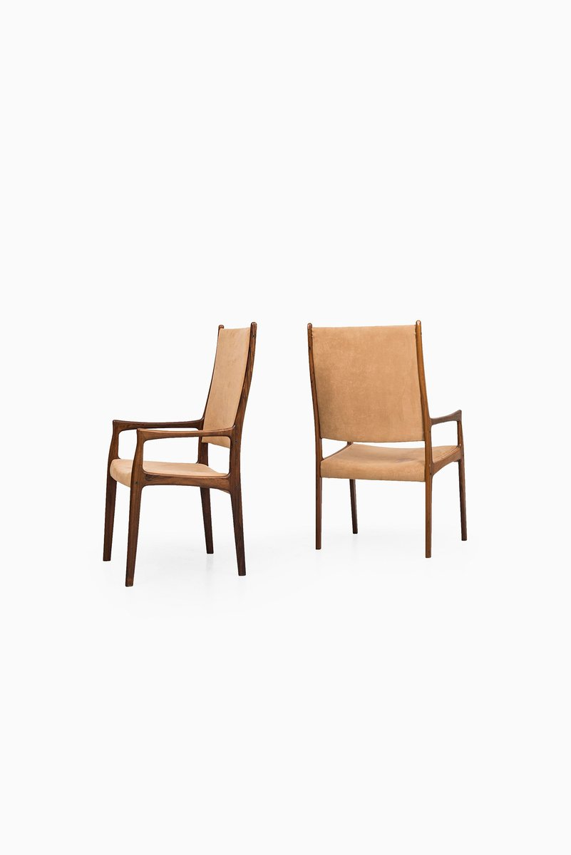 rosewood and faux suede dining chairs by johannes andersen