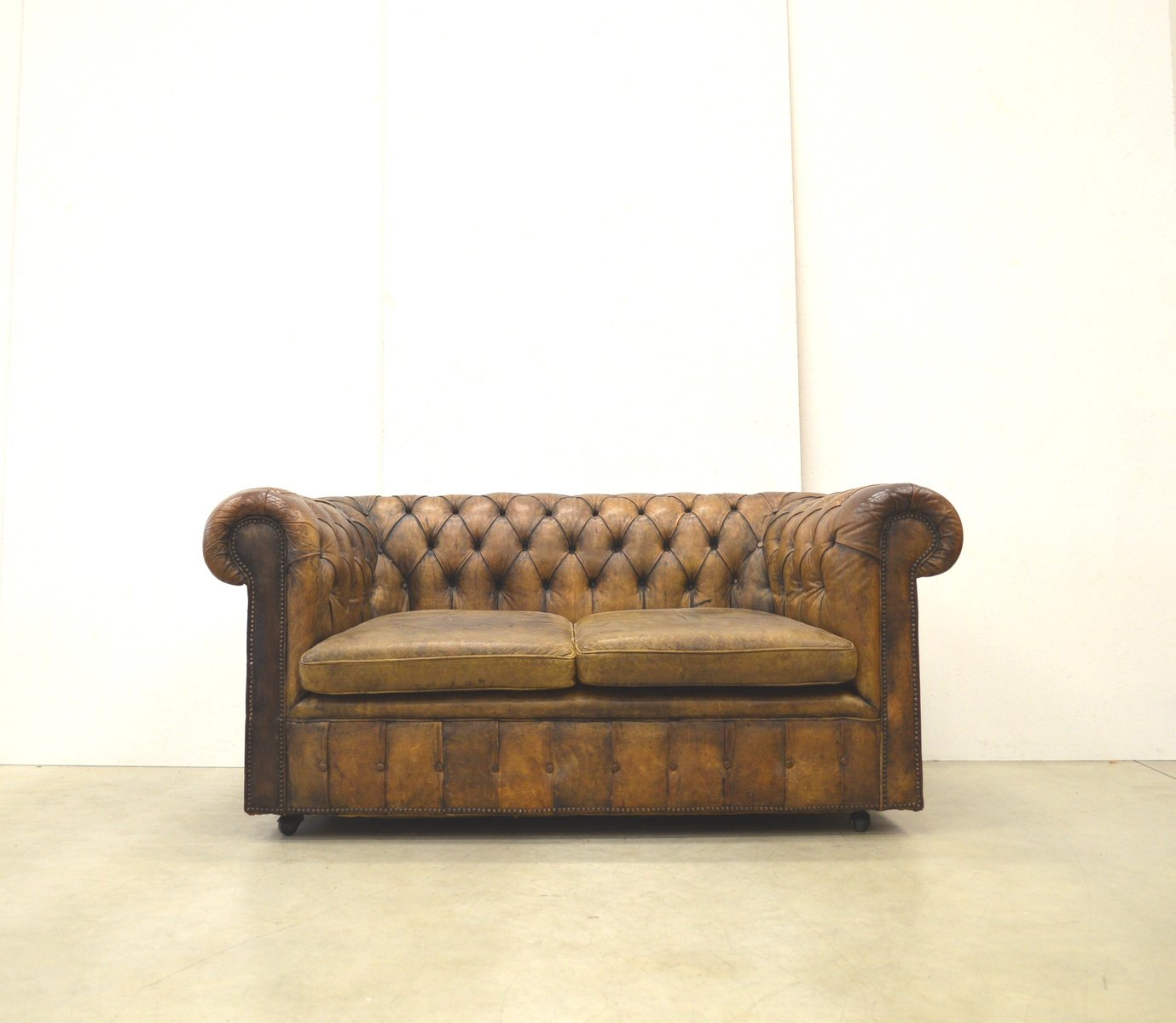 vintage english gold brown leather chesterfield two seater. Black Bedroom Furniture Sets. Home Design Ideas