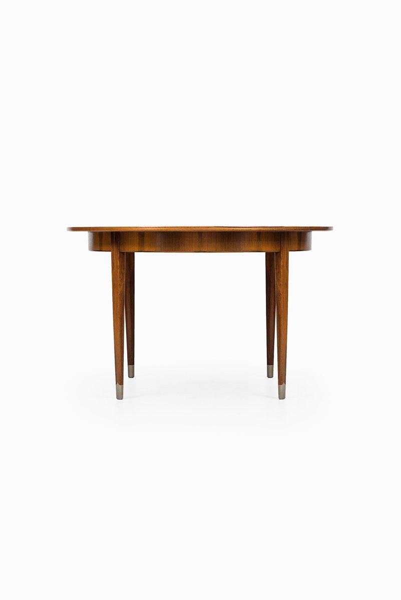 Table de salle manger en palissandre et en acier par for Table salle a manger acier