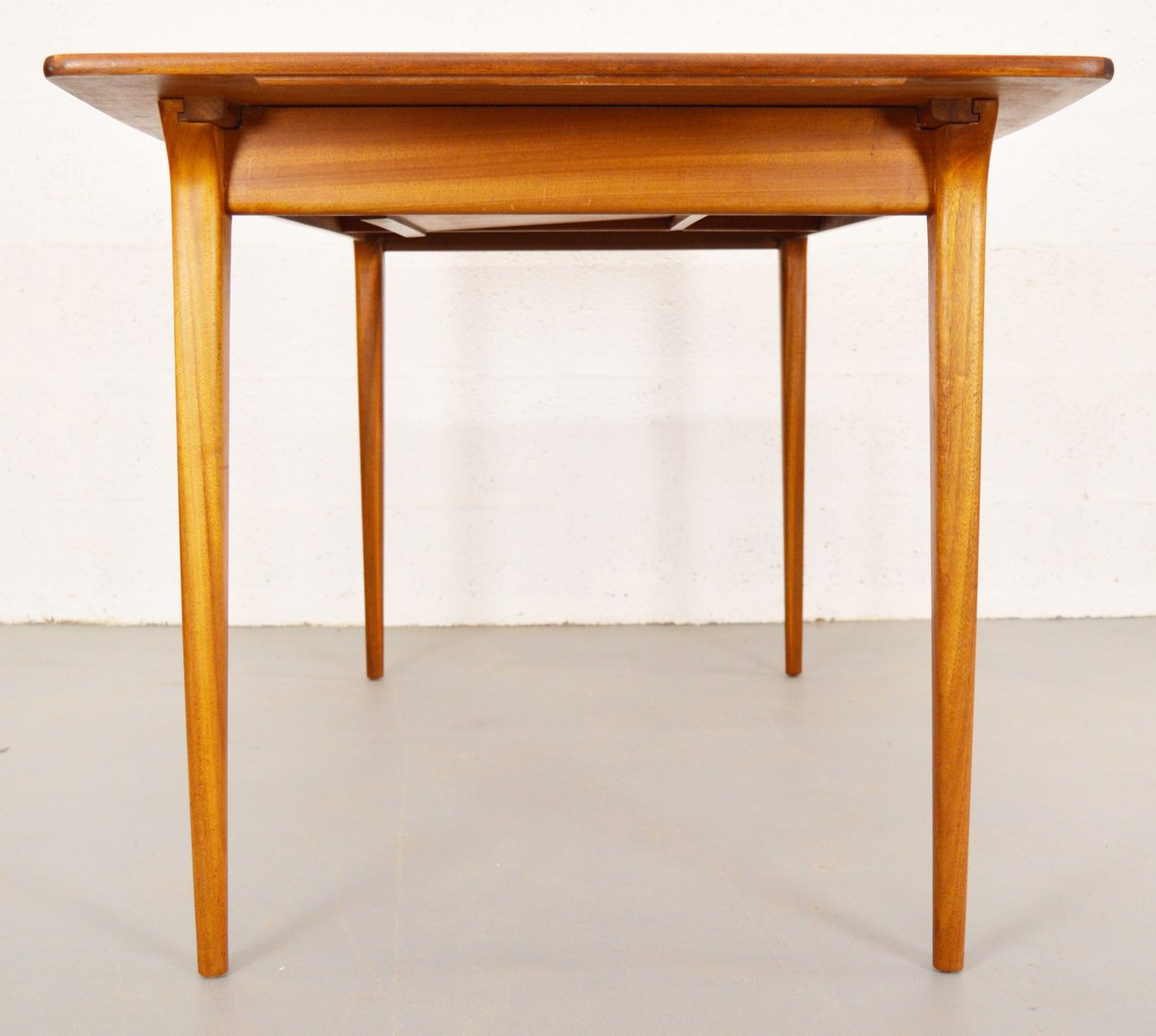 Mid Century Extendable Boat Shaped Teak Dining Table From McIntosh For Sale A