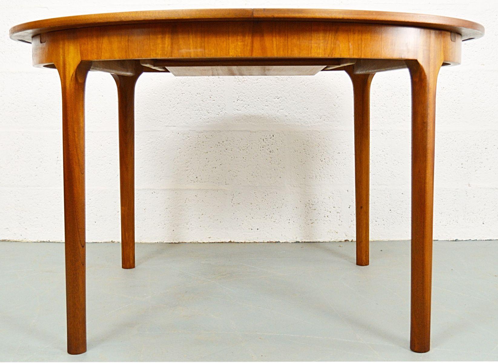 Mid century extendable round teak dining table from for Mid century round dining table