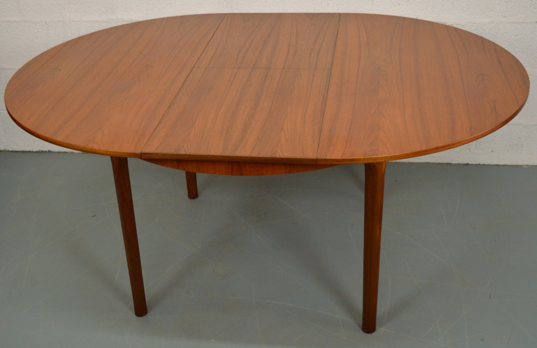 Mid century extendable round teak dining table from for Round extendable dining table