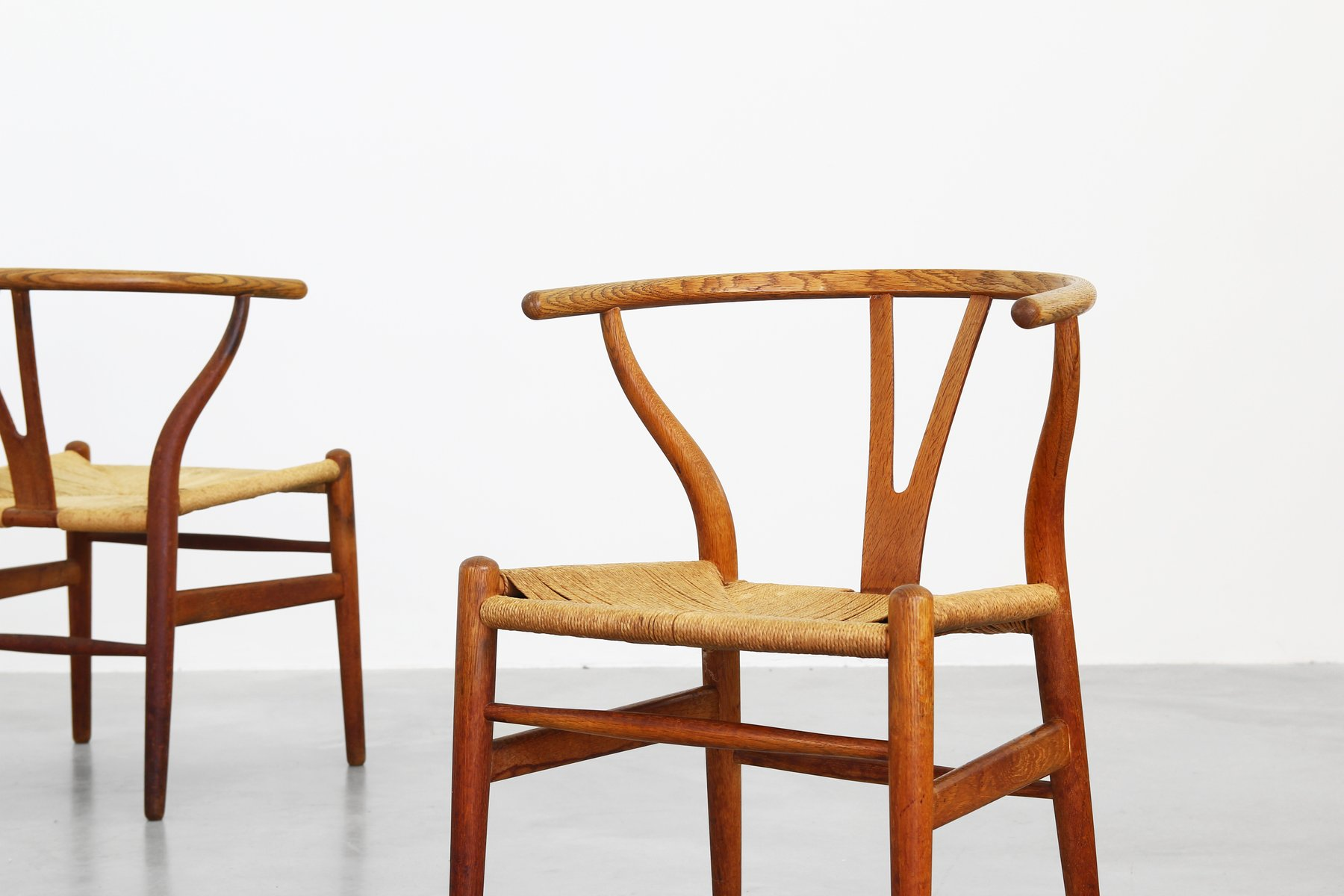 Danish oak wishbone dining chairs by hans j wegner for for Oak dining chairs