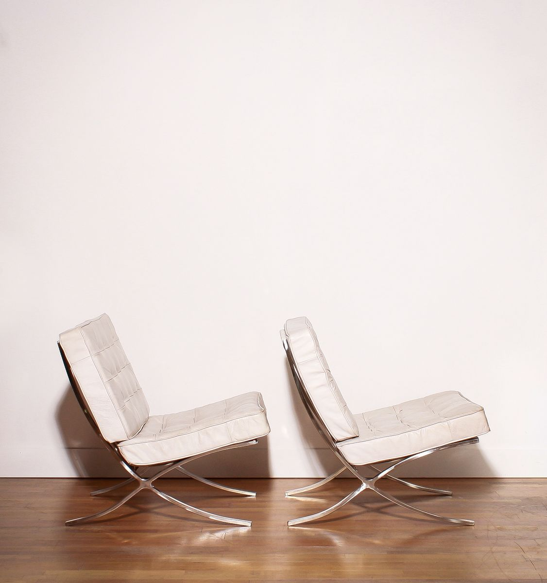 White Leather Barcelona Lounge Chairs and Ottoman by Ludwig Mies van der Rohe