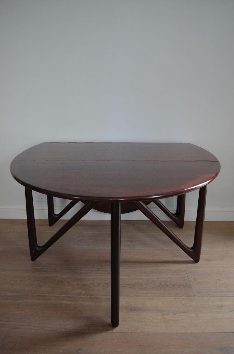 Table de salle manger ovale en palissandre par kurt for Salle a manger table ovale