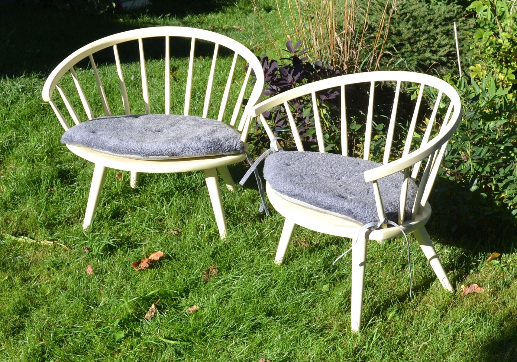 arka wooden chairs with sheepskin cushions by yngve