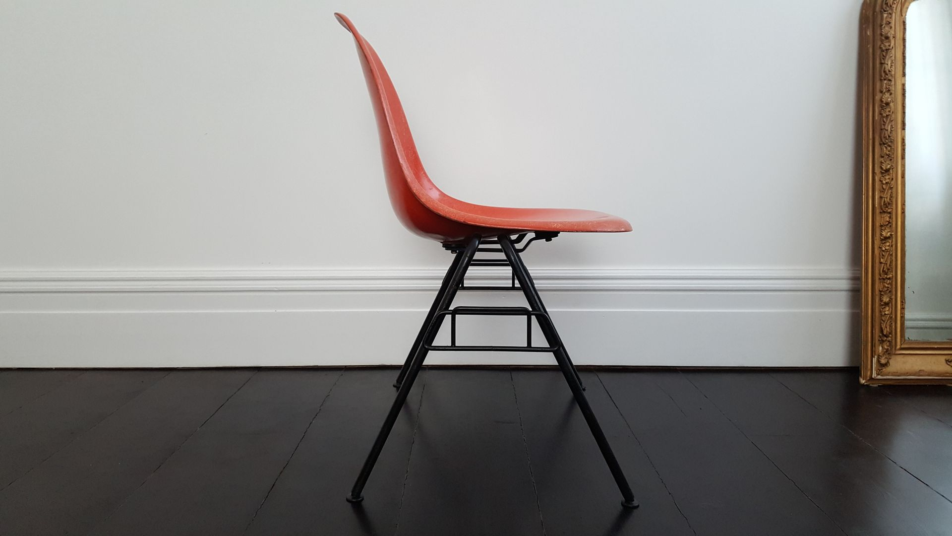 Orange DSS Fiberglass Stacking Chair by Charles & Ray Eames for