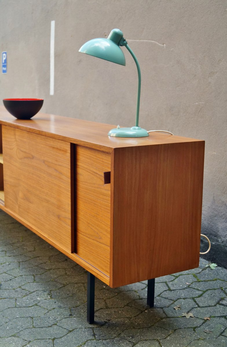 Minimalist sideboard with sliding doors and leather handles from minimalist sideboard with sliding doors and leather handles from deutsche werksttten vtopaller Gallery