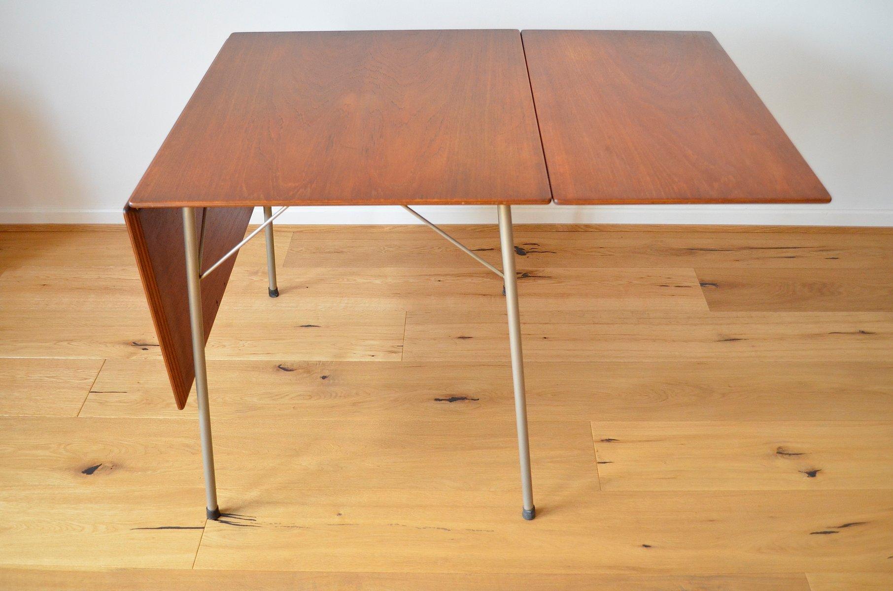 table de salle à manger pliante modèle 3601 en teck par arne