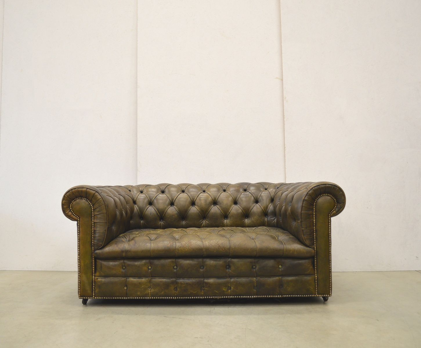 english olive green leather chesterfield two seater sofa. Black Bedroom Furniture Sets. Home Design Ideas