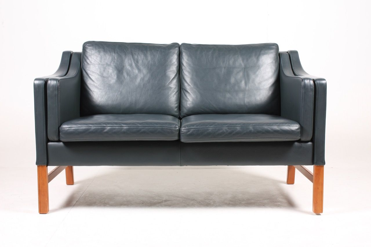 Danish dark blue leather two seater sofa by takashi Blue leather sofa