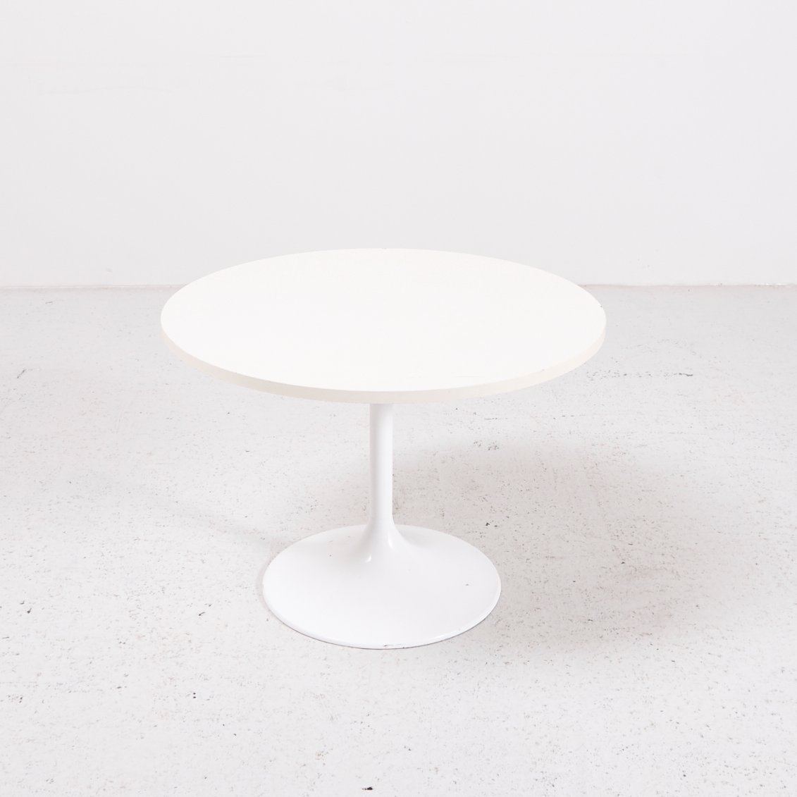 midcentury side table with funnel shaped leg