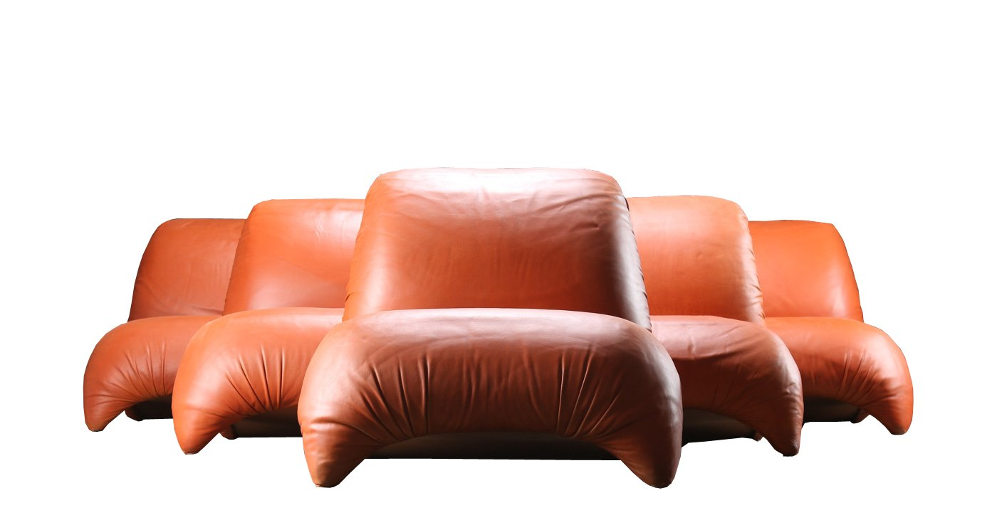 midcentury modern lounge chair in cognac leather