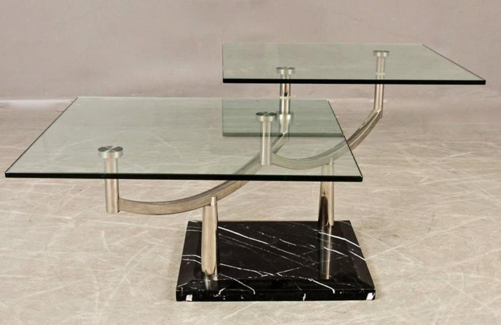 two-tiered glass coffee table with a chrome frame & stone base for