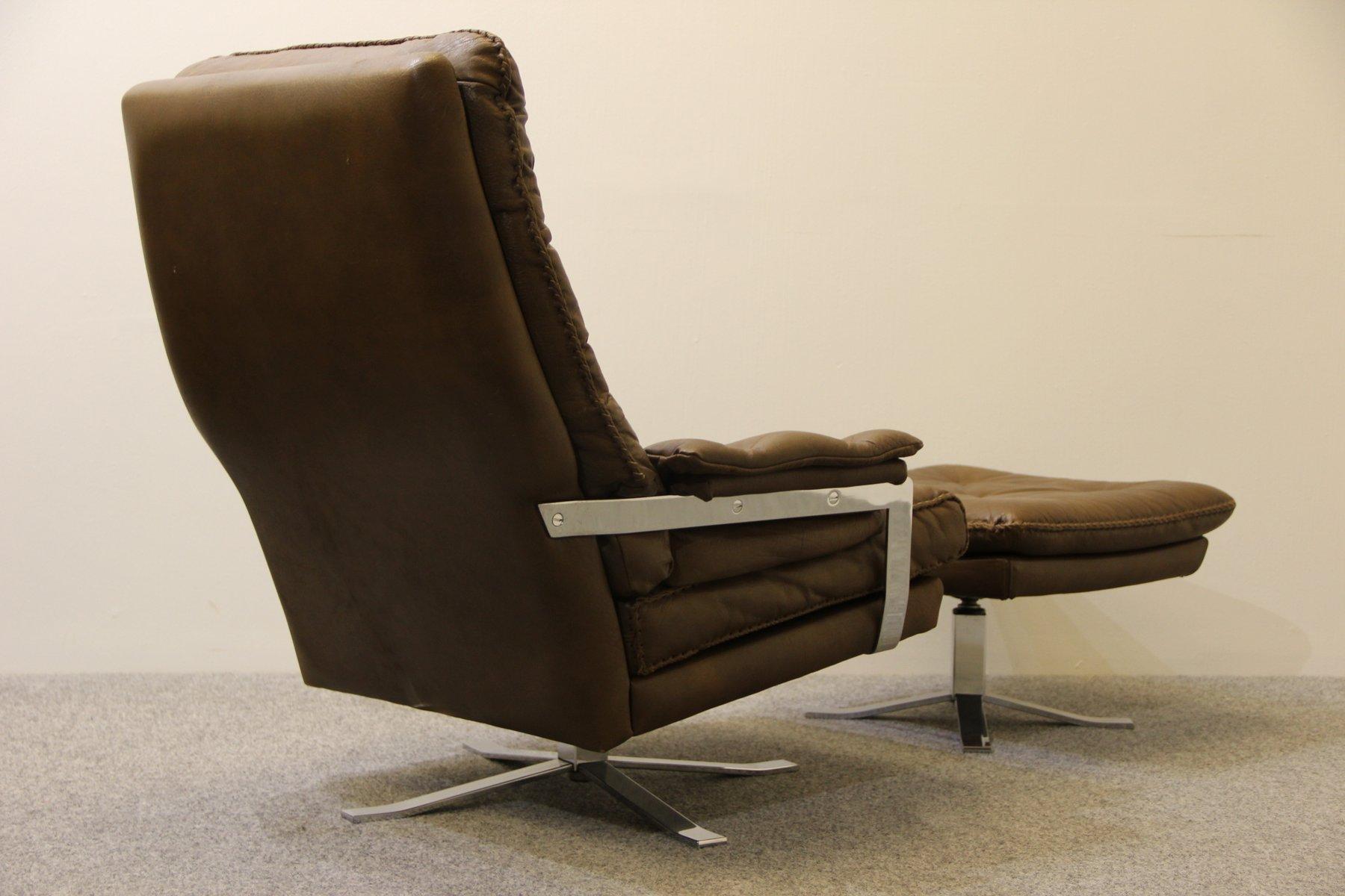 fauteuil et repose pied retro en cuir de buffle par arne. Black Bedroom Furniture Sets. Home Design Ideas
