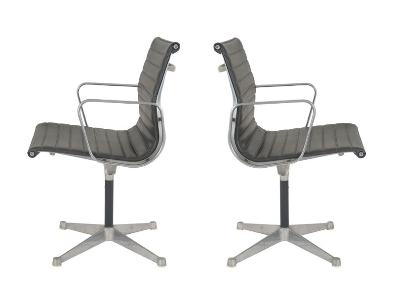 Vintage ea107 swivel chairs by charles ray eames for - Chaise eames belgique ...